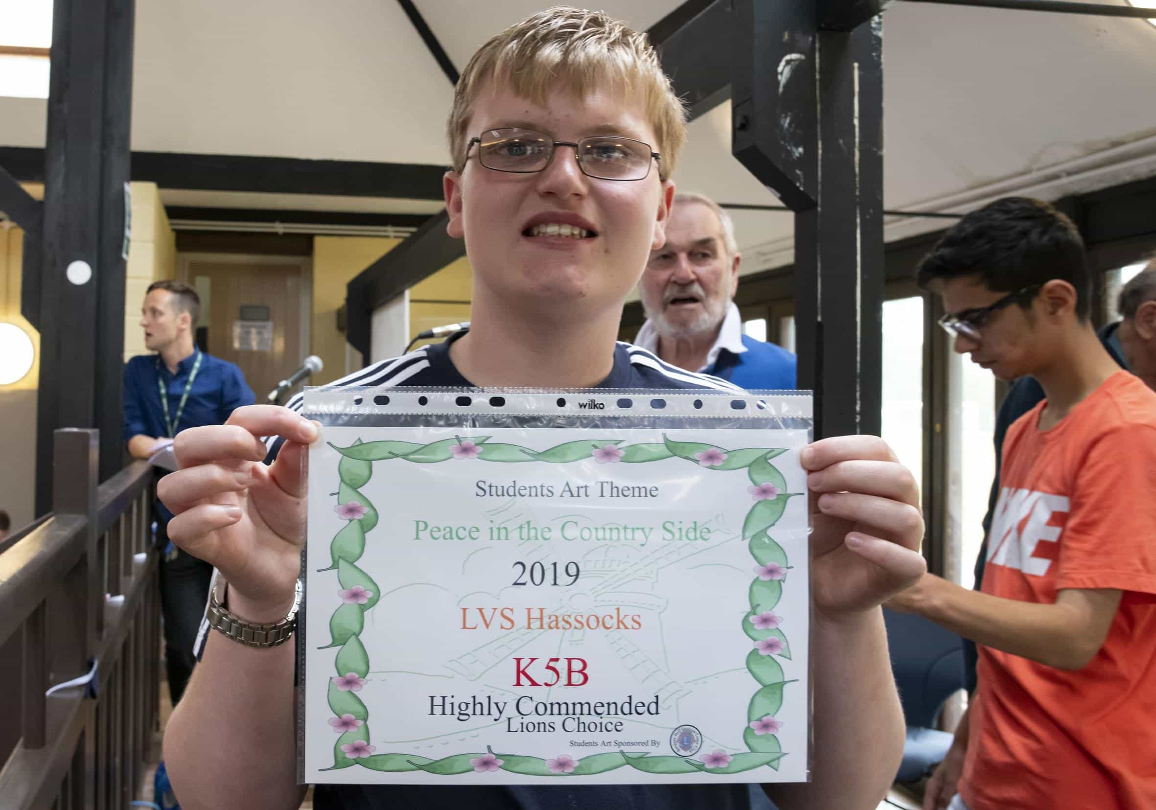 Boys holds certificate