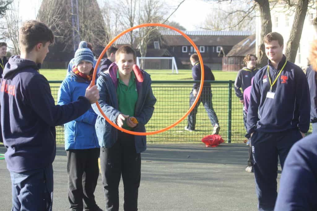boy pupil wants to do the hula hoop in school playground