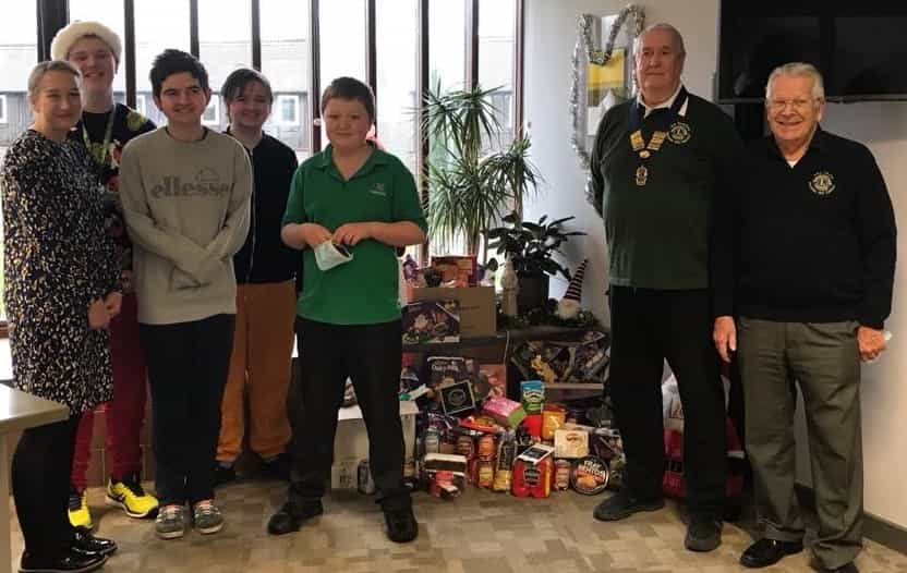 Students from LVS Hassocks stand by their gifts